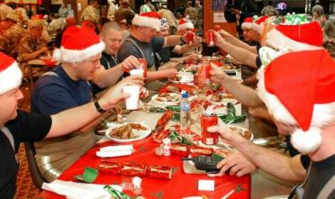 British members of the Royal Air Force Search and Rescue team toast before a special Christmas lunch in Basra